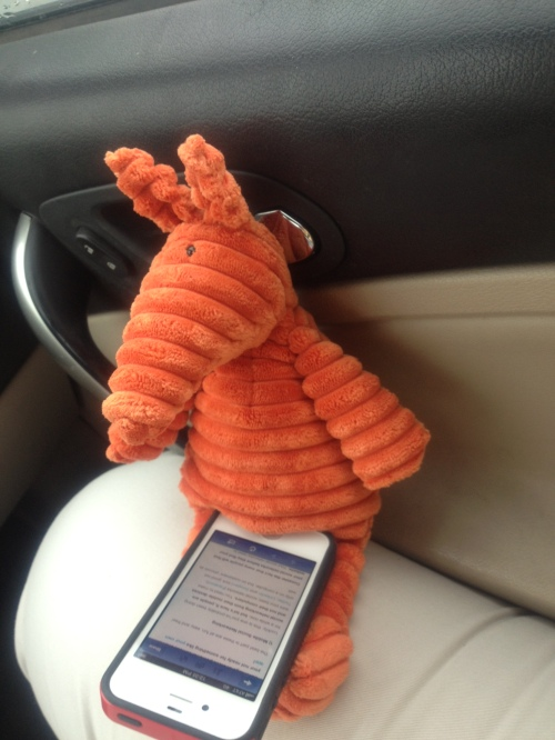 Never one to waste time, Clive catches up in the car on an article about mobile marketing.